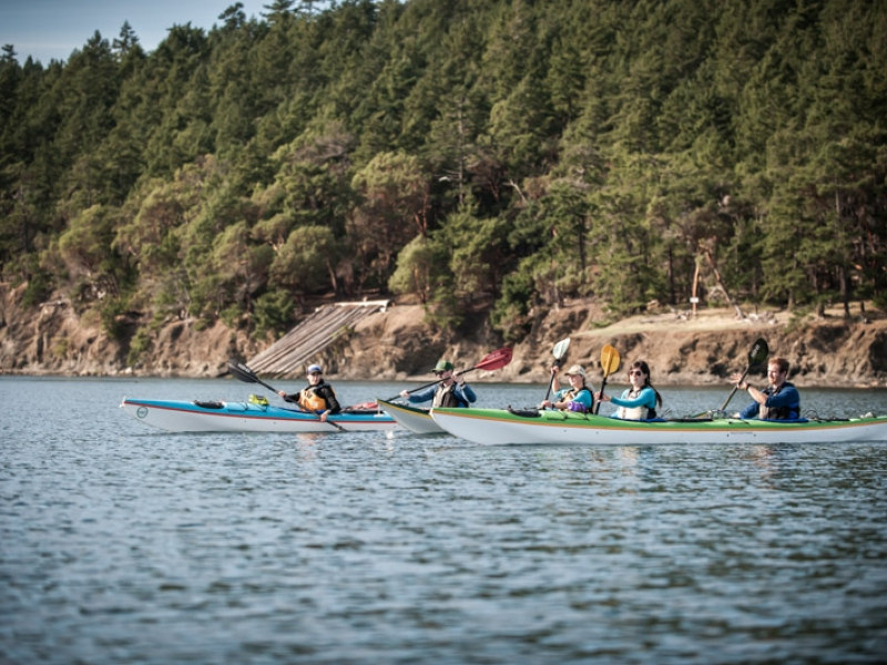 Explore small islands and view nature preserves while sea kayaking with San Juan Island Outfitters