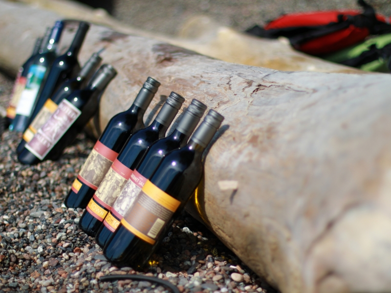 Enjoy wine on the beach after a day of kayaking the San Juan Islands