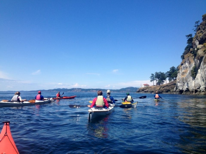After flying in, join a kayak tour on San Juan Island