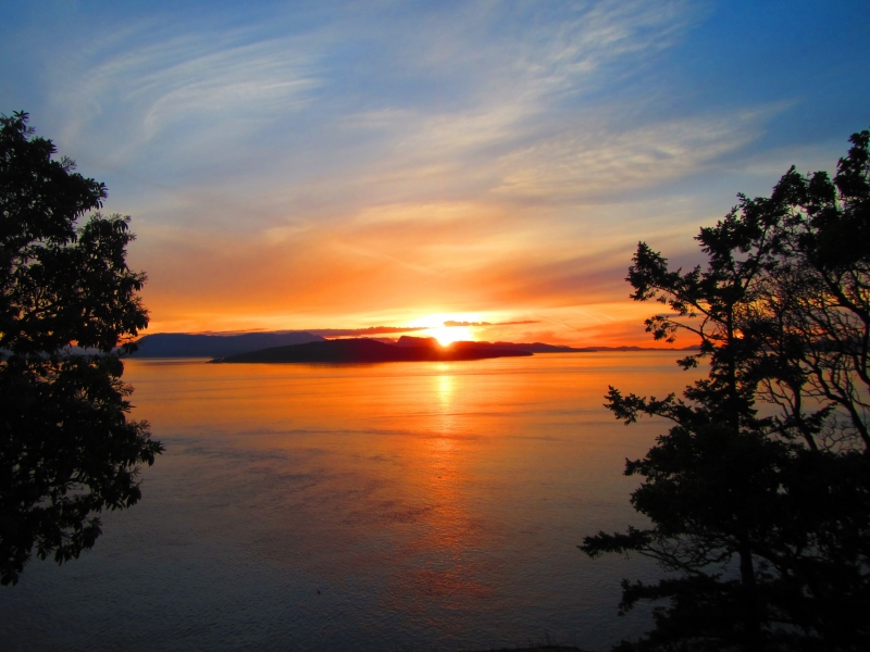 Sunset Views from Stuart Island while kayak camping with San Juan Outfitters