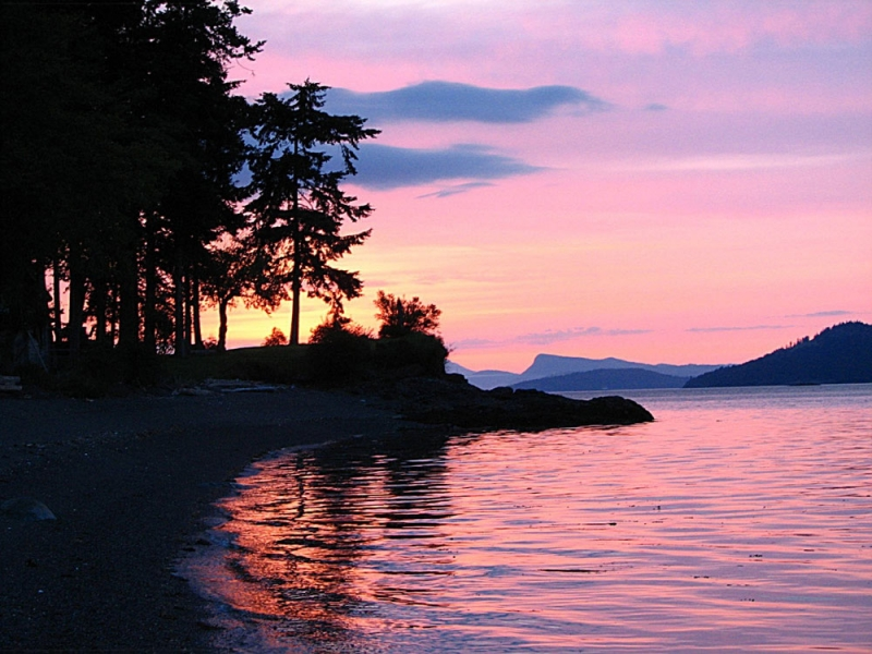 Watch the amazing San Juan sunsets while kayak camping with San Juan Island Outfitters